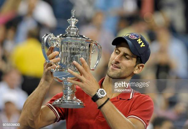 Novak Djokovic holds the trophy aloft after winning the Men's Singles Final against Rafael Nadal of Spain on Day Fifteen of the 2011 US Open at the...
