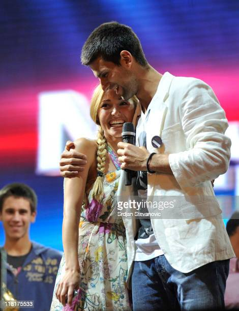 Novak Djokovic hugs his girlfriend Jelena Ristic as he speaks to the crowd during a ceremony to welcome him home following his victory at the 2011...