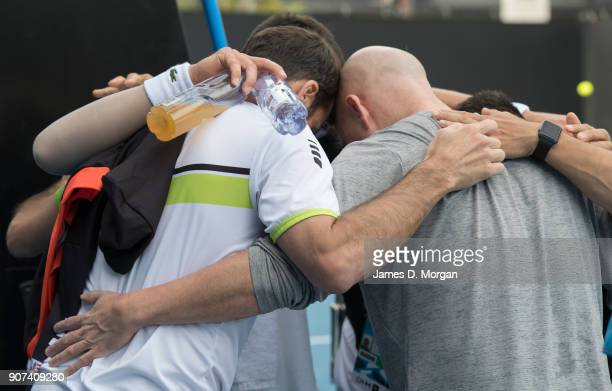 Novak Djokovic hugs his team members after practice on day six of the 2018 Australian Open at Melbourne Park on January 20 2018 in Melbourne Australia