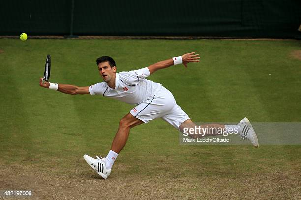 Novak Djokovic in action against Roger Federer during the Men's final on day thirteen of the Wimbledon Lawn Tennis Championships at the All England...