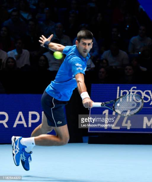 Novak Djokovic in action against Roger Federer during their match on Day Five of the Nitto ATP Finals at The O2 Arena on November 14 2019 in London...