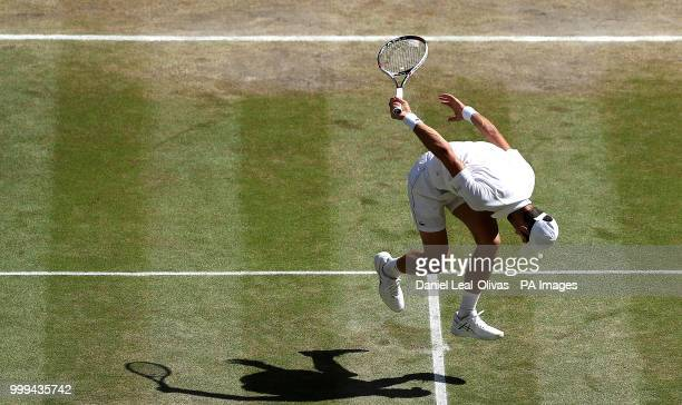 Novak Djokovic in action on day thirteen of the Wimbledon Championships at the All England Lawn Tennis and Croquet Club Wimbledon