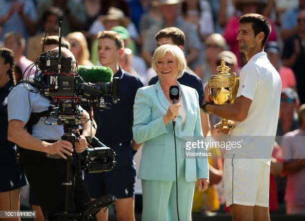 Novak Djokovic is interviewed by Sue BArker of the BBC after winning the Men's Singles Final on day thirteeen of the Wimbledon Lawn Tennis...