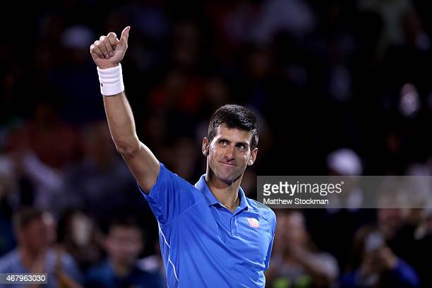 Novak Djokovic of Serbia acknowledges the crowd after his win over Martin Klizan of Slovakia during day 6 of the Miami Open Presented by Itau at...