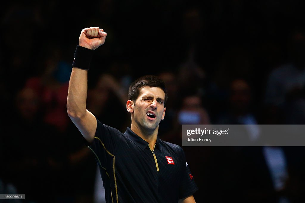 Novak Djokovic of Serbia acknowledges the crowd after victory in the singles semi-final match against Kei Nishikori of Japan on day seven of the Barclays ATP World Tour Finals at O2 Arena on November 15, 2014 in London, England.