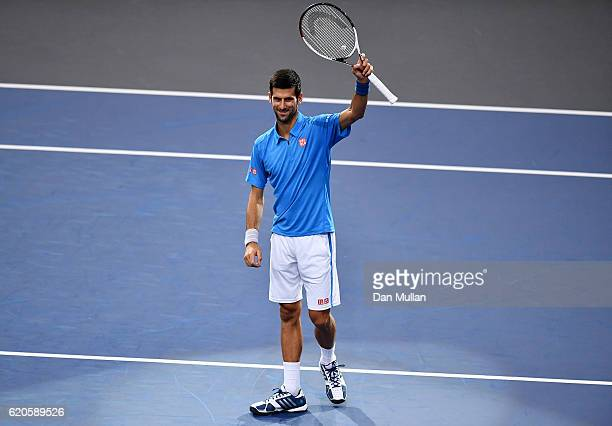 Novak Djokovic of Serbia acknowledges the crowd following his victory against Gilles Muller of Luxembourg during the Mens Singles second round match...