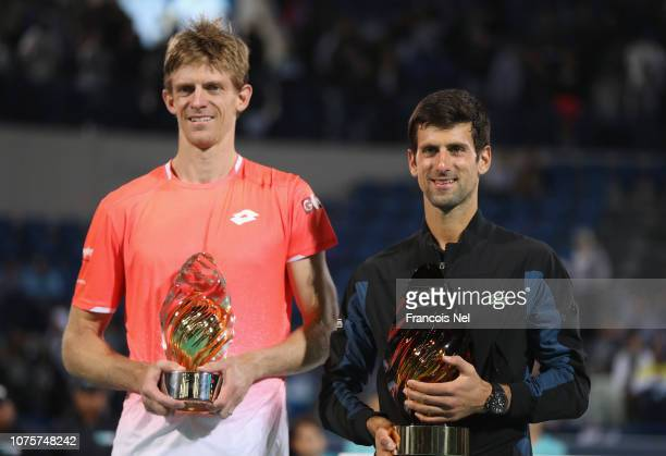 Novak Djokovic of Serbia after winning the Men's Singles finals match alongside runner up Kevin Anderson of South Africa at Mubadala World Tennis...