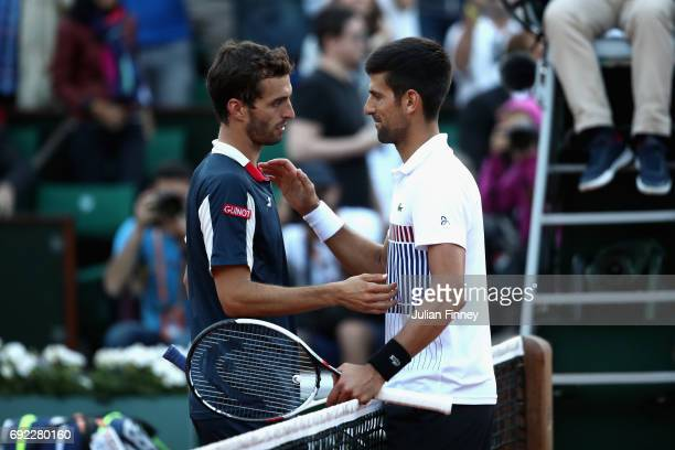 Novak Djokovic of Serbia and Albert RamosVinolas of Spain shake hands following the mens singles fourth round match on day eight of the 2017 French...