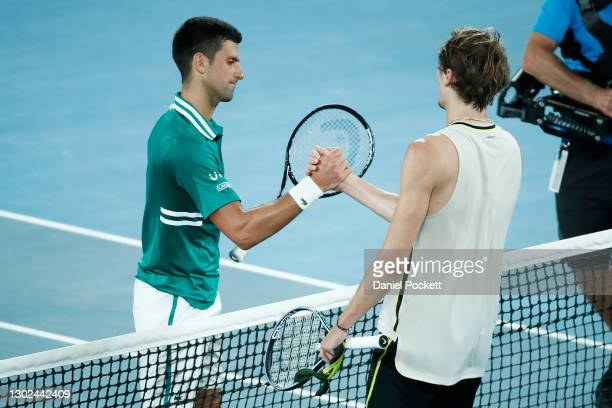 Novak Djokovic of Serbia and Alexander Zverev of Germany embrace at the net following their Men's Singles Quarterfinals match during day nine of the...
