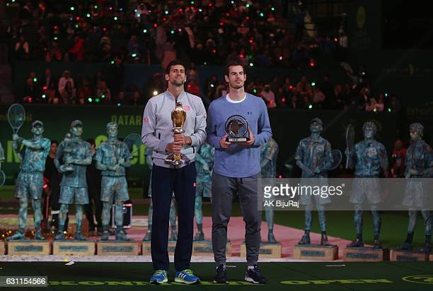 Novak Djokovic of Serbia and Andy Murray of Great Britain pose for a photo after the men's singles final of the ATP Qatar Open tennis competition...