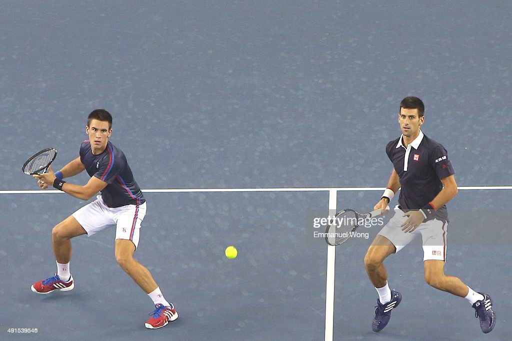 Novak Djokovic of Serbia and Djordje Djokovic of Serbia returns a ball against Mao-Xin Gong of China and Michael Venus of New Zealand during the day four of the 2015 China Open at the China National Tennis Center on October 6, 2015 in Beijing, China.
