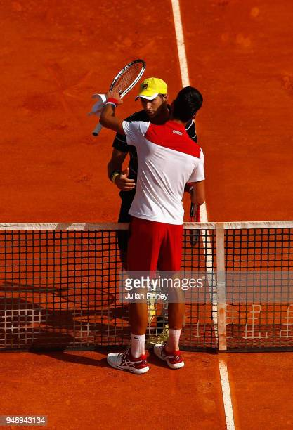 Novak Djokovic of Serbia and Dusan Lajovic of Serbia hug after their singles match against Dusan Lajovic of Serbia during day two of ATP Masters...