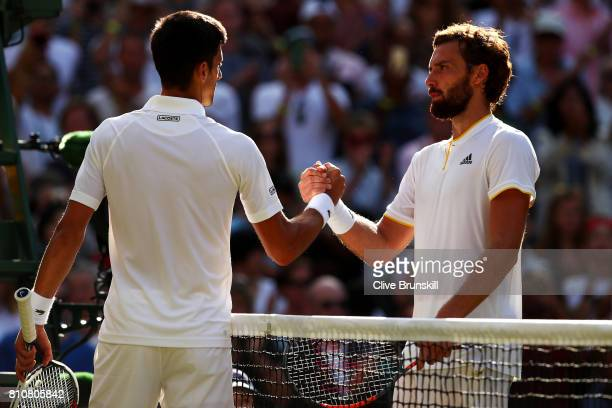 Novak Djokovic of Serbia and Ernests Gulbis of Latvia shake hands after the Gentlemen's Singles third round match on day six of the Wimbledon Lawn...