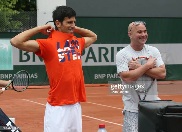 Novak Djokovic of Serbia and his coach Andre Agassi at practice on day 3 of the 2017 French Open second Grand Slam of the season at Roland Garros...