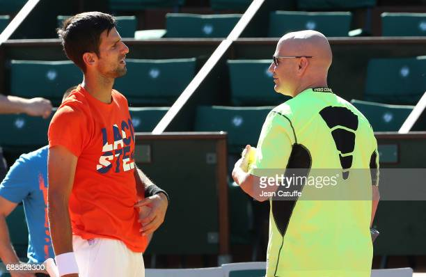 Novak Djokovic of Serbia and his new coach Andre Agassi during practice on Court Central two days ahead of the start of 2017 French Open at Roland...