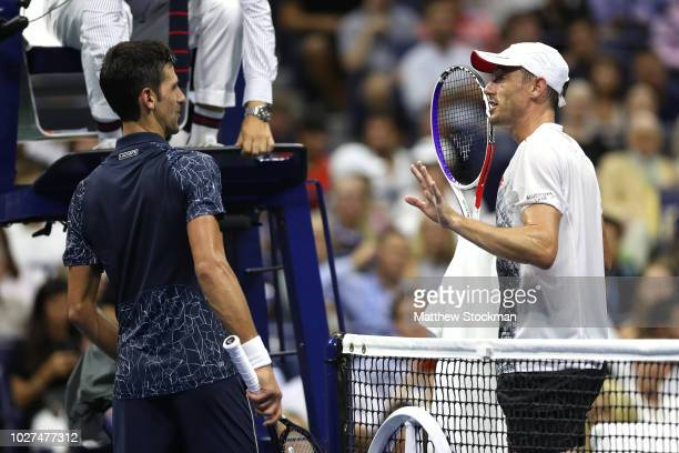 Novak Djokovic of Serbia and John Millman of Australia argue in the second set during their men's singles quarterfinal match on Day Ten of the 2018...