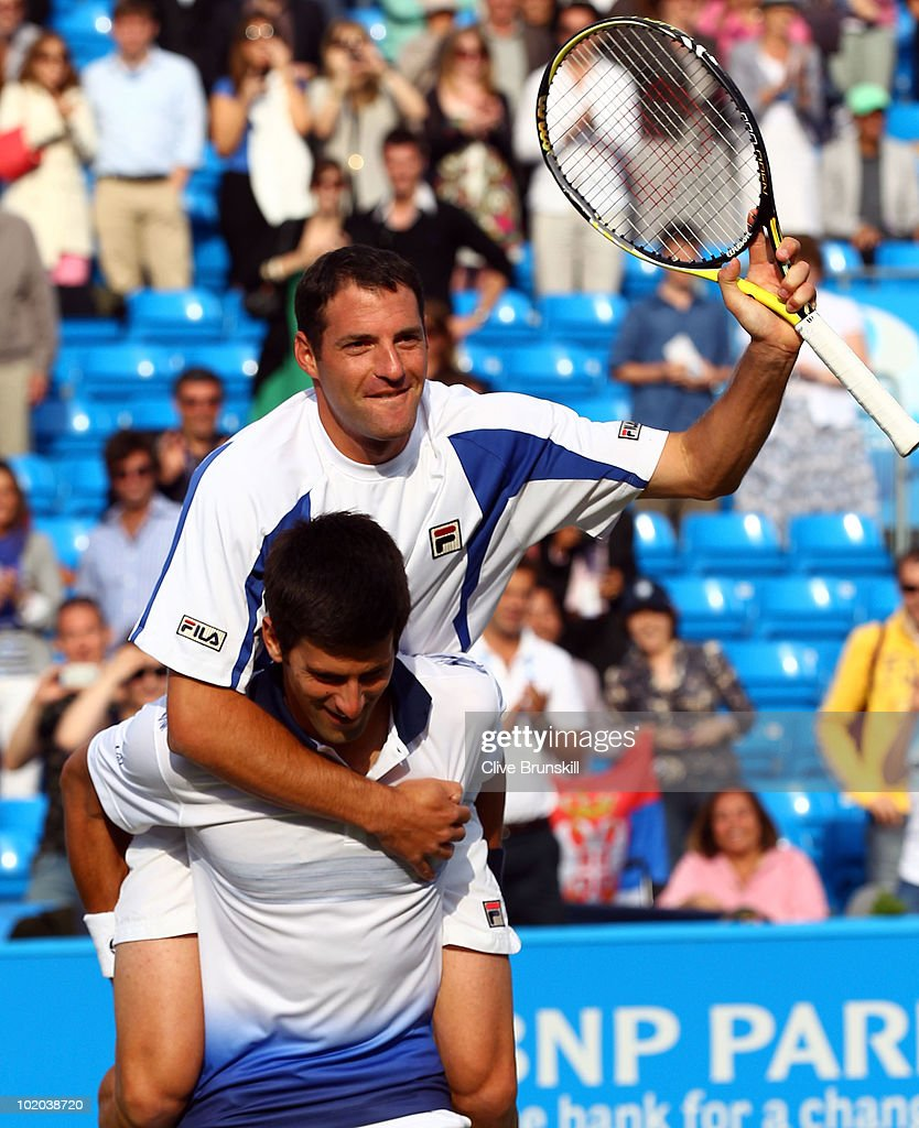 Novak Djokovic of Serbia and Jonathan Erlich of Israel celebrates winning their doubles final match against Karol Beck of Slovakia and David Skoch of Czech Republic on Day 7 of the the AEGON Championships at Queen's Club on June 13, 2010 in London, England.