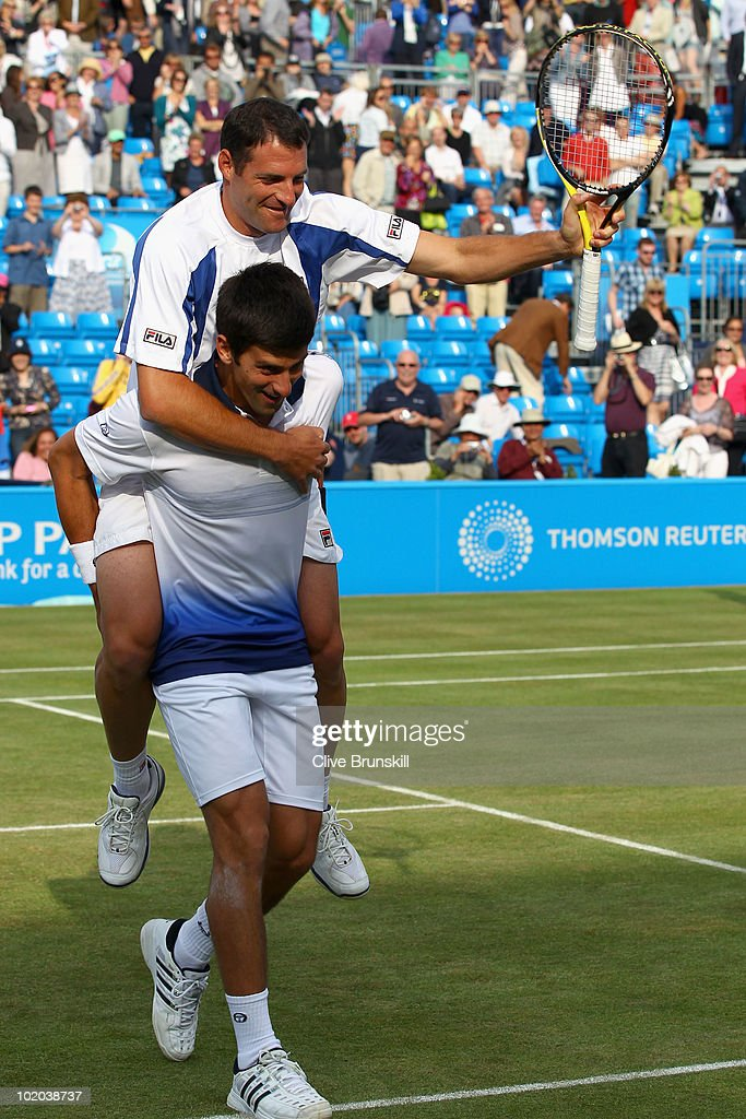 Novak Djokovic of Serbia (R) and Jonathan Erlich of Israel celebrates winning their doubles final match against Karol Beck of Slovakia and David Skoch of Czech Republic on Day 7 of the the AEGON Championships at Queen's Club on June 13, 2010 in London, England.