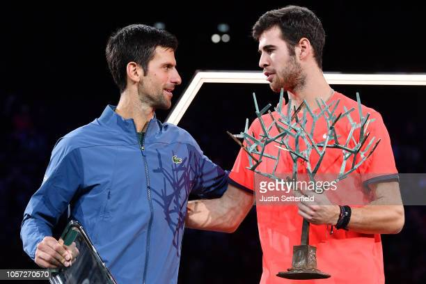 Novak Djokovic of Serbia and Karen Khachanov of Russia pose with their trophys after Karen Khachanov wins the Men's Final during Day Seven of the...