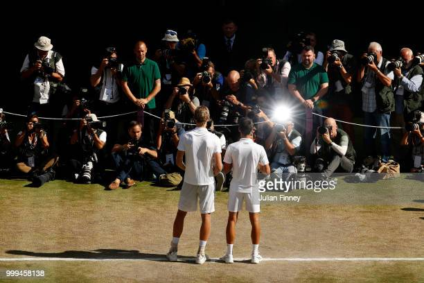 Novak Djokovic of Serbia and Kevin Anderson of South Africa pose together with their trophies after the Men's Singles final on day thirteen of the...