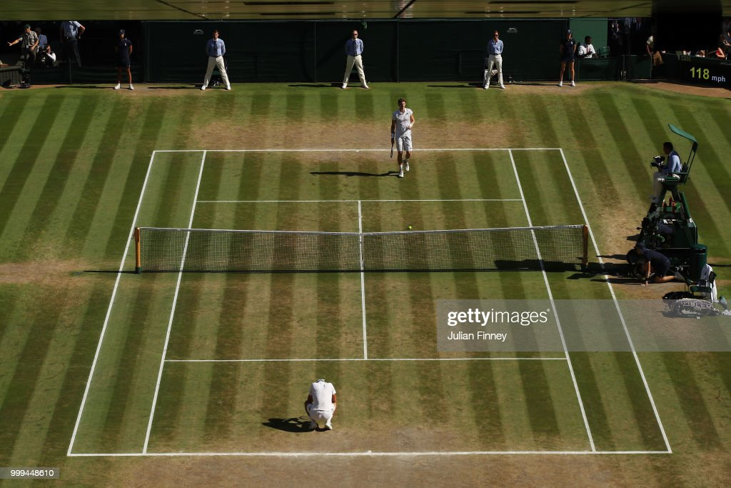 Novak Djokovic of Serbia and Kevin Anderson of South Africa react to Championship point during the Men's Singles final on day thirteen of the Wimbledon Lawn Tennis Championships at All England Lawn Tennis and Croquet Club on July 15, 2018 in London, England.