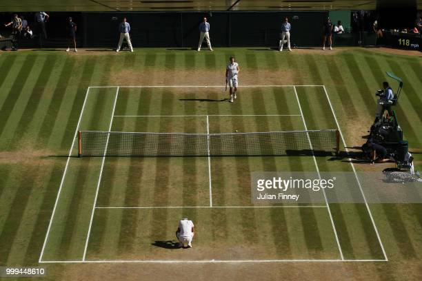 Novak Djokovic of Serbia and Kevin Anderson of South Africa react to Championship point during the Men's Singles final on day thirteen of the...