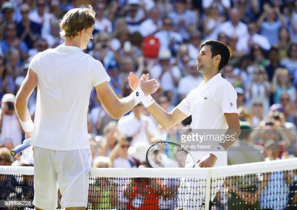 Novak Djokovic of Serbia and Kevin Anderson of South Africa shake hands after the Wimbledon men's singles final in London on July 15 2018 Djokovic...
