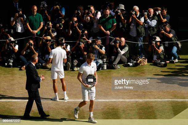 Novak Djokovic of Serbia and Kevin Anderson of South Africa with their trophies after the Men's Singles final on day thirteen of the Wimbledon Lawn...