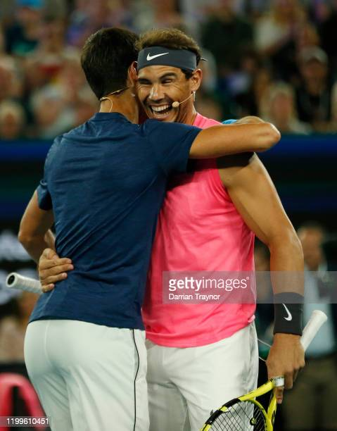 Novak Djokovic of Serbia and Rafael Nadal of Spain hug during the Rally for Relief Bushfire Appeal event at Rod Laver Arena on January 15 2020 in...