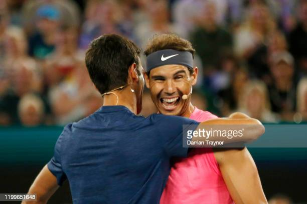 Novak Djokovic of Serbia and Rafael Nadal of Spain hug during the Rally for Relief Bushfire Appeal event at Rod Laver Arena on January 15, 2020 in...
