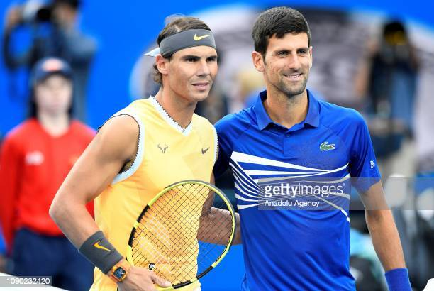 Novak Djokovic of Serbia and Rafael Nadal of Spain pose after their Men's Singles Final match during day 14 of the 2019 Australian Open on January 27...