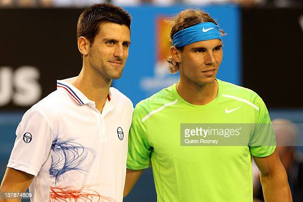 Novak Djokovic of Serbia and Rafael Nadal of Spain pose prior to their men's final match during day fourteen of the 2012 Australian Open at Melbourne...