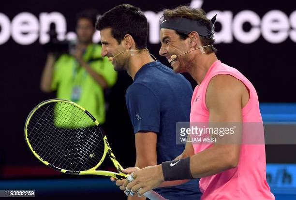 Novak Djokovic of Serbia and Rafael Nadal of Spain share a lighter moment as they and other top players play in the Rally for Relief charity tennis...