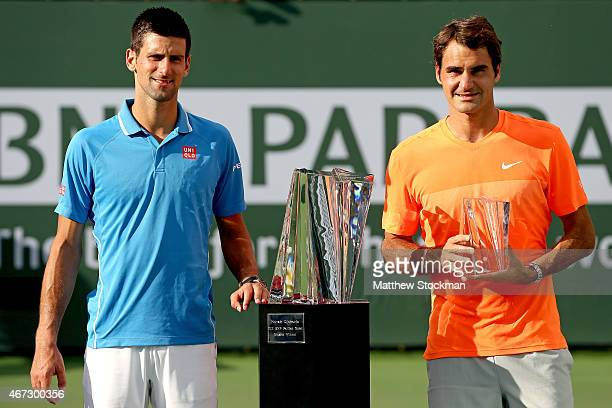 Novak Djokovic of Serbia and Roger Federer of Switzerland pose for photographers after the final on day fourteen of the BNP Paribas Open at the...