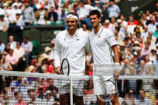 Novak Djokovic of Serbia and Roger Federer of Switzerland pose together before the Gentlemen's Singles Final match on day thirteen of the Wimbledon...