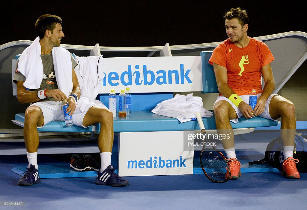 Novak Djokovic of Serbia (L) and Stan Wawrinka of Switzerland (R) share a light moment during a practice session ahead of the Australian Open tennis tournament in Melbourne on January 14, 2016.