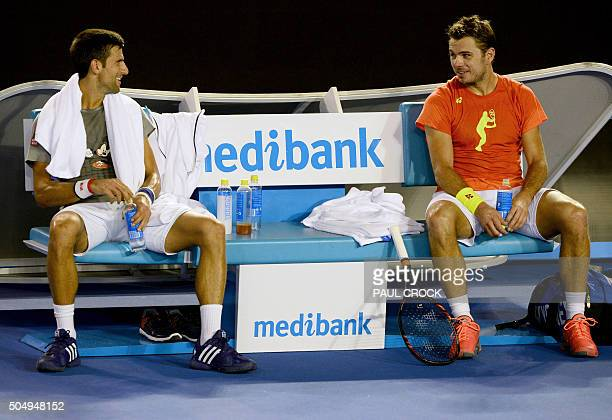 Novak Djokovic of Serbia and Stan Wawrinka of Switzerland share a light moment during a practice session ahead of the Australian Open tennis...