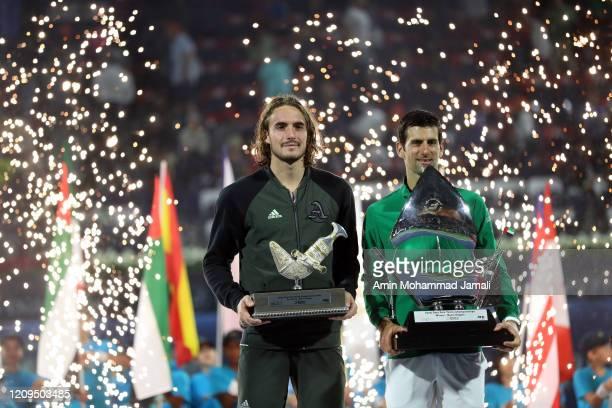 Novak Djokovic of Serbia and Stefanos Tsitsipas celebrate with the victor's trophy after the final Match Day thirteen of the Dubai Duty Free Tennis...