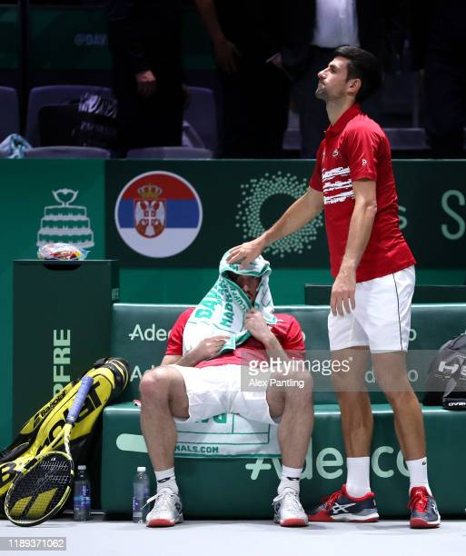 Novak Djokovic of Serbia and team mate Viktor Troicki react following defeat during their quarter final doubles match on Day Five of the 2019 Davis...