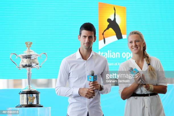 Novak Djokovic of Serbia and Victoria Azarenka of Belarus talk during the 2014 Australian Open official draw at Melbourne Park on January 10 2014 in...