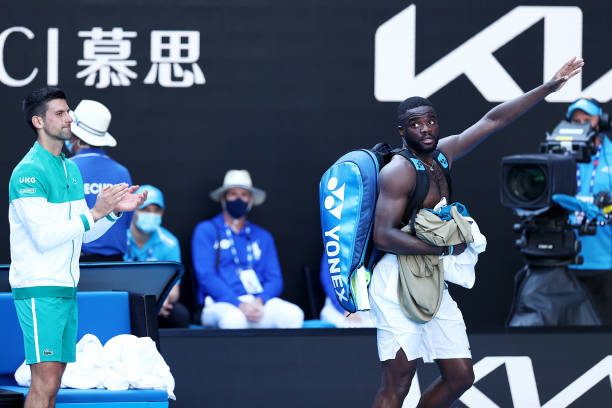 Novak Djokovic of Serbia applauds Frances Tiafoe of the United States after their Men's Singles second round match during day three of the 2021...