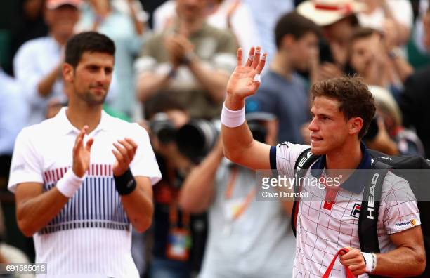 Novak Djokovic of Serbia applauds his opponent Diego Schwartzman of Argentina as he leaves the court following defeat in the mens singles third round...