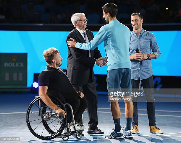 Novak Djokovic of Serbia arrives and meets Australian tennis legend Roy Emerson during 'A Night with Novak' at Margaret Court Arena on January 11...