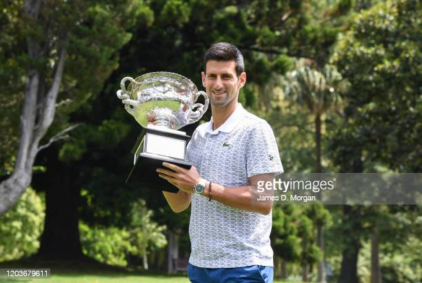 Novak Djokovic of Serbia at a photo call with the Norman Brookes Challenge Cup during the 2020 Australian Open Men's Trophy Media Opportunity at The...