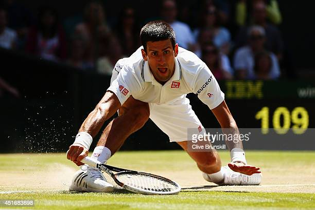 Novak Djokovic of Serbia bends down low to make a return during his Gentlemen's Singles semifinal match against Grigor Dimitrov of Bulgaria on day...