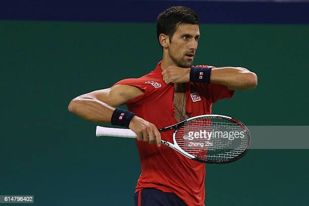 Novak Djokovic of Serbia breaks his shirt against Roberto Bautista Agut of Spain during the Men's singles semifinal match on day 7 of Shanghai Rolex...