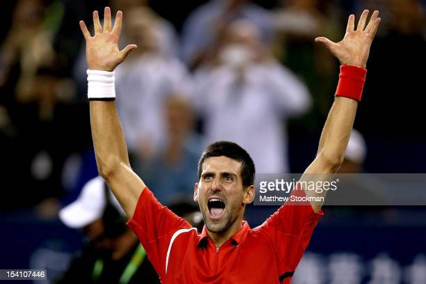 Novak Djokovic of Serbia ceebrates his win over Andy Murray of Great Britain during the final of the Shanghai Rolex Masters at the Qi Zhong Tennis...