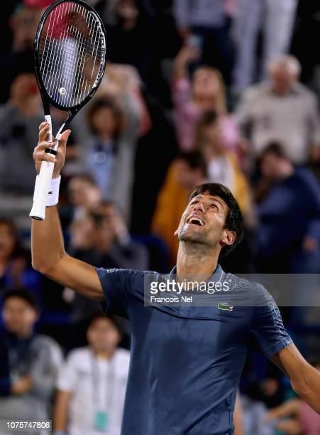Novak Djokovic of Serbia celebartes after winning the men's final match of the Mubadala World Tennis Championship at International Tennis Centre...