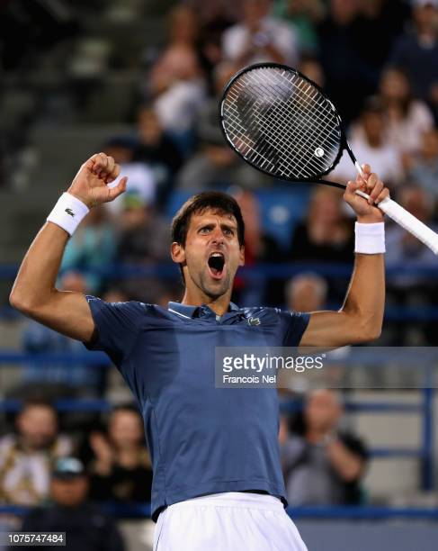 Novak Djokovic of Serbia celebartes against Kevin Anderson of South Africa during the men's final match of the Mubadala World Tennis Championship at...