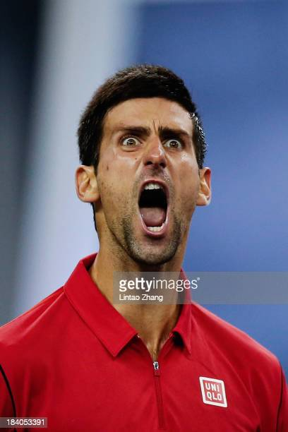 Novak Djokovic of Serbia celebrates a point against Gael Monfils of France during day five of the Shanghai Rolex Masters at the Qi Zhong Tennis...